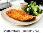 wiener schnitzel  veal cutlet...   Shutterstock . vector #1008047761