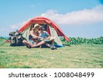 hipster couple resting in tent...   Shutterstock . vector #1008048499