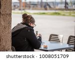 woman having breakfast outdoors   Shutterstock . vector #1008051709