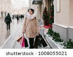 girl with packages goes down...   Shutterstock . vector #1008055021