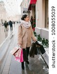 girl with packages goes down...   Shutterstock . vector #1008055039