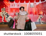 girl with packages goes down...   Shutterstock . vector #1008055051