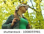 young girl with a backpack on a ...   Shutterstock . vector #1008055981