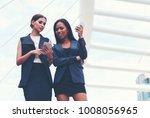 two businesswoman holding...   Shutterstock . vector #1008056965
