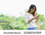 happy young woman holding...   Shutterstock . vector #1008056989