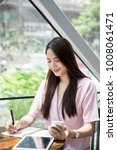 young asian business owner...   Shutterstock . vector #1008061471