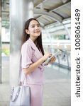 young asian business owner...   Shutterstock . vector #1008061489