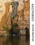 Small photo of Waterfall in mountain canyon Ein Avdat National park and reserve. Negev, Israel
