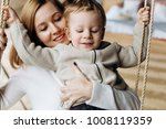 charming mother has fun with... | Shutterstock . vector #1008119359