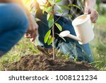 couple planting and watering a... | Shutterstock . vector #1008121234