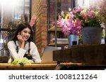 women florist looking laptop... | Shutterstock . vector #1008121264