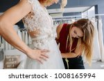 skillful dress designer fitting ... | Shutterstock . vector #1008165994