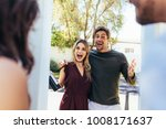 excited couple at entrance door ... | Shutterstock . vector #1008171637