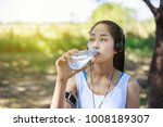young sporty woman drinking... | Shutterstock . vector #1008189307