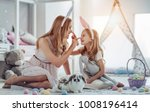 Stock photo attractive young woman with little cute girl are preparing for easter celebration mom and daughter 1008196414