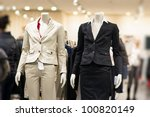 Black and white suits on mannequins in mall - stock photo