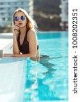 young model woman in black... | Shutterstock . vector #1008202351
