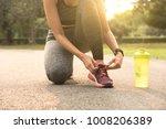 runner women tie running shoes... | Shutterstock . vector #1008206389
