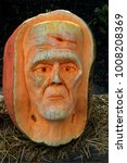 Small photo of Carving of a creepy or silly face to add Halloween cheer to your porch.