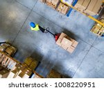 male warehouse worker pulling a ... | Shutterstock . vector #1008220951