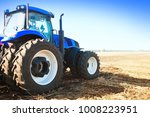 Blue Tractor In A Field On A...