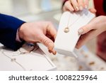 man buying necklace in jewelry... | Shutterstock . vector #1008225964