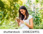 a cheerful woman in a park... | Shutterstock . vector #1008226951
