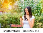 a young woman being upset while ... | Shutterstock . vector #1008232411