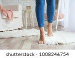 woman walking on fluffy carpet... | Shutterstock . vector #1008246754