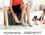 young woman trying on shoes in... | Shutterstock . vector #1008248197