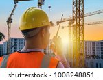 Leadership is very necessary for being a leader,Construction work needs certainty,precision,Engineers are in control use communication tools,Heavy construction yellow crane for heavy lifting. - stock photo