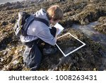 student on a field trip. using... | Shutterstock . vector #1008263431