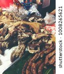Small photo of Asian Traditional Street with mix Boiled pork intestine and duck , lamb, liver, chicken offal in a shop on local market in The north of Thailand. vintage ton color