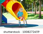kids climbing and sliding on... | Shutterstock . vector #1008272659