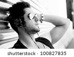 Portrait of handsome man in urban background with aviator sunglasses - stock photo