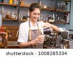 asian barista woman make a... | Shutterstock . vector #1008285334