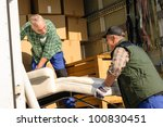 two male movers putting... | Shutterstock . vector #100830451