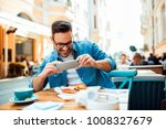 smiling modern young man taking ... | Shutterstock . vector #1008327679