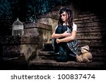 Small photo of Adolescent lolita schoolgirl sitting on stairs looking sad
