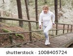 Woman Climbing Stairs During...