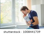 father with newborn child.... | Shutterstock . vector #1008441739