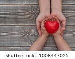 the hands of the child and the... | Shutterstock . vector #1008447025