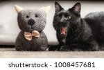 cute black cat with his tongue... | Shutterstock . vector #1008457681
