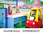 child playing in toy shop or... | Shutterstock . vector #1008483625