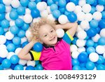 child playing in ball pit.... | Shutterstock . vector #1008493129