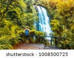 woman hiker enjoys waterfall... | Shutterstock . vector #1008500725