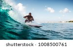 young man rides the ocean wave. ... | Shutterstock . vector #1008500761