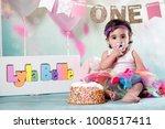 baby girl cake smash | Shutterstock . vector #1008517411