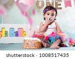 baby girl cake smash | Shutterstock . vector #1008517435