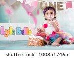 baby girl cake smash | Shutterstock . vector #1008517465